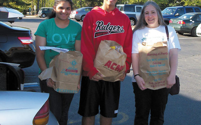 Volunteers, from left, Jessica Singh, Jaswin Singh, and Lorraine Fisch go shopping for the Jewish Family and Children's Service food pantry in June. Photo courtesy Jewish Family and Children's Service of Greater Mercer County