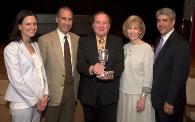 With Cantor Murray Simon as he displays the Kiddush cup given to him by the Jewish Center for his years of service are, from left, Rabbi Annie Tucker; congregation president Jesse Treu, Toby Simon, and Rabbi Adam Feldman.