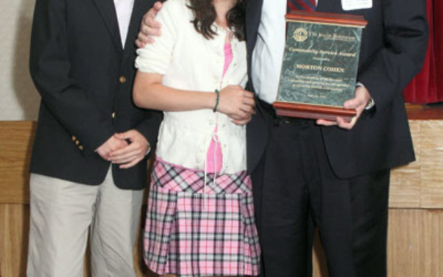 Community Service Award recipient Mort Cohen with his children, Ben and Abby Cohen.