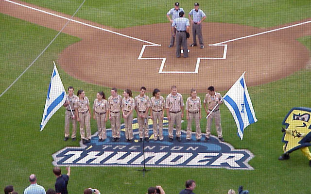 """Members of Tzofim prepare to sing the """"Hatikva"""" prior to the opening pitch. Photos by Matt Schuman"""