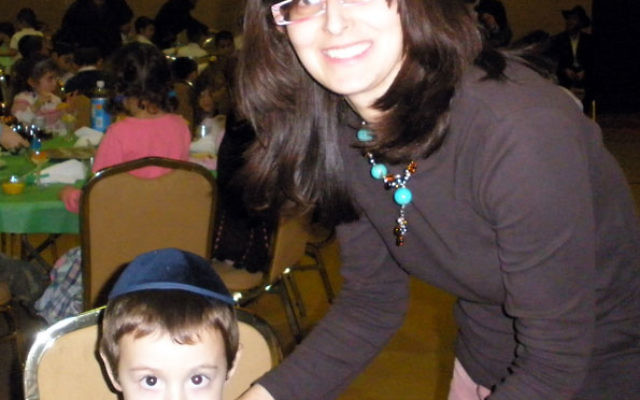 Chanie Zaklikovsky, a director of Cheder Menachem in North Brunswick, with Elchonon Greenbaum, the four-year-old son of Rabbi Akiva and Zeesy Greenbaum, codirectors of the Chabad Center for Jewish Life at the College of New Jersey in Ewing.