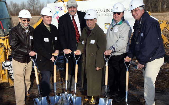 Taking part in the Feb. 1, 2009, ceremonial ground-breaking ceremony at the campus site are, from left, Donald Leibowitz, president of the JCC of Princeton Mercer Bucks; Howard Cohen; Ken Mack and Daniel Brent, former United Jewish Federation of Princeton
