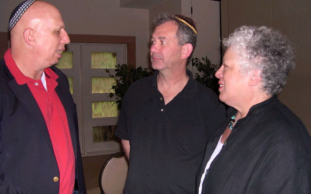 Hillel Zaremba, left, at Adath Israel May 15, with Jonathan Miller, congregation vice-president and cochair of the Israel Festival, and Hedda Morton, director of congregational learning.