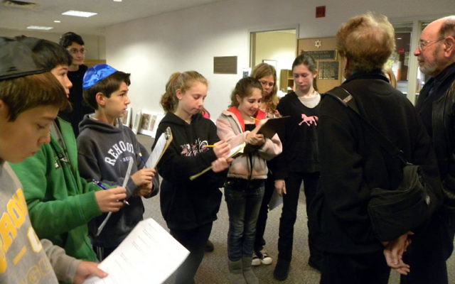 Zayin (seventh-grade) students at The Jewish Center interview community members for a synagogue history project. Photos courtesy The Jewish Center of Princeton