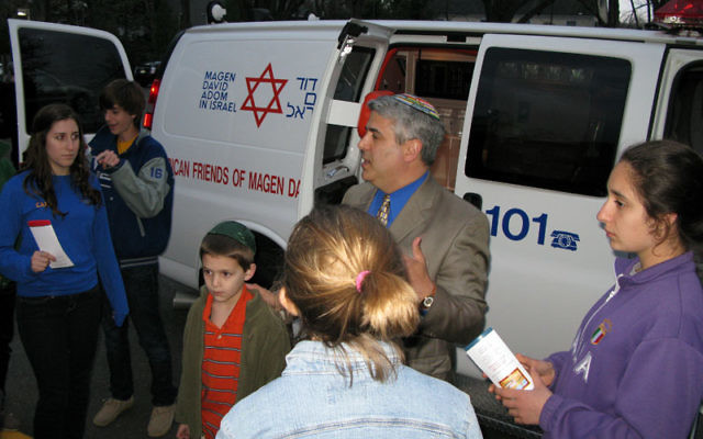 When Rabbi Adam Feldman heard that a new American Friends of Magen David Adom ambulance donated by a Philadelphia-area donor was on its way to New York for shipment to Israel, he asked that it make a stop at The Jewish Center. The synagogue's Tichon