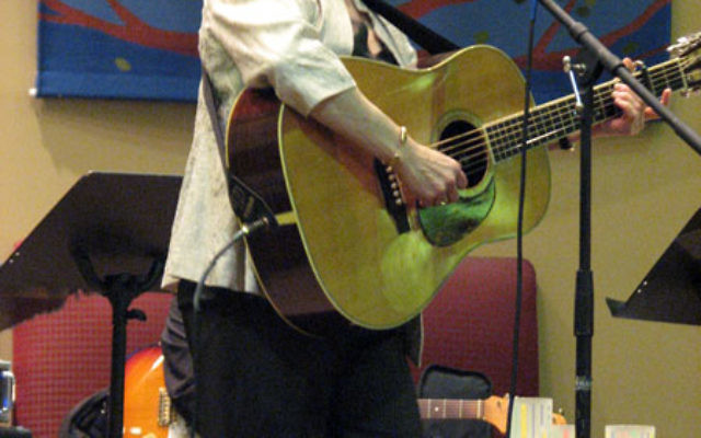 Debbie Friedman performs in a North Brunswick synagogue in 2009. Photo by Bobbi Binder