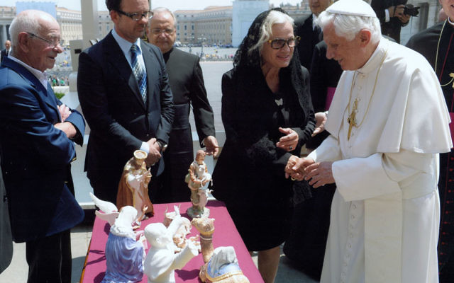 Sharon Lee Parker, the owner of Boehm Porcelain in Trenton, presents a collection of 18 pieces to Pope Benedict XVI on May 25 to add to the Vatican's already extensive collection of Boehm creations. Photos courtesy Boehm Porcelain