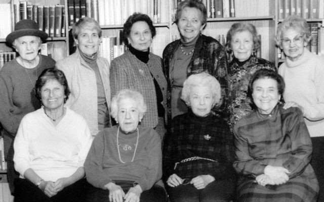 Phyllis Kurshan, standing, second from left, and Marion Epstein, seated, far right — shown here in a 1995 photograph — are among the few remaining original founders of The Jewish Center.