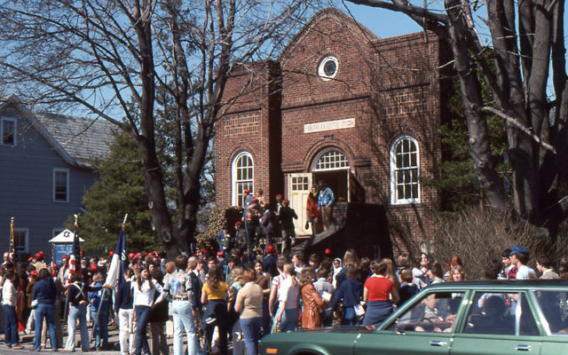 Beth El members gather at the synagogue on Franklin Street, built in 1937, preparing to carry the Torah scrolls in a procession to the new building on Maple Stream Road, March 27, 1977. Photos courtesy Beth El Synagogue