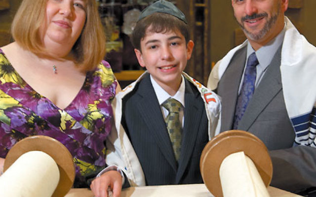 Monica Schneider, although not Jewish, was able to stand on the bima together with her husband Jeffrey as their son, Derek, became a bar mitzva on May 29 — the result of a small but significant change in how aliyot are choreographed at Th