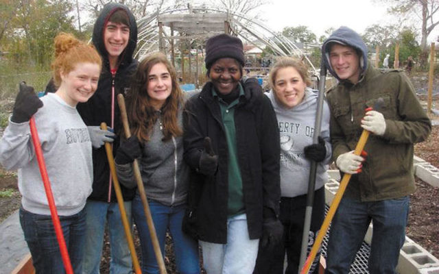 "Among the Young Judaeans volunteering at a community garden in New Orleans are, from left, Abby and Solomon Park of Lawrenceville, Sequoia Sellinger, ""Miss Deborah,"" Shelby Lipson of East Brunswick, and Eddie Maza. Photos courtesy Shelby Lipso"