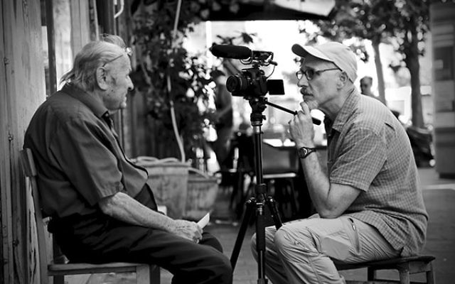 "Filmmaker and ""Jersey boy"" Marc Kornblatt, right, interviews retired photographer Azriel Klar on King George Street in Tel Aviv for Kornblatt's YouTube series ""Rock Regga."""