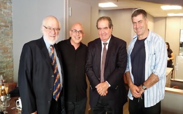 From left, Nathan Lewin, Sima Soumekhian, Supreme Court Justice Antonin Scalia and Marc Zweben at the Char Bar in Washington, D.C., the kosher restaurant owned by Soumekhian and Zweben, May 2015. (Alyza Lewin)