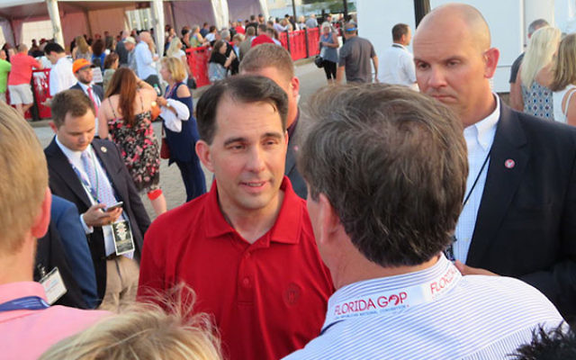 Wisconsin Gov. Scott Walker greeting attendees at the opening bash of the Republican National Convention in Cleveland, July 17, 2016. (Ron Kampeas)