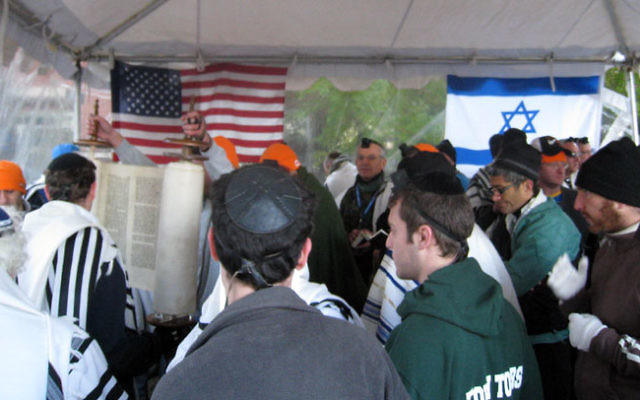 Runners take some time for prayers before the marathon. Photo courtesy Peter Berkowsky