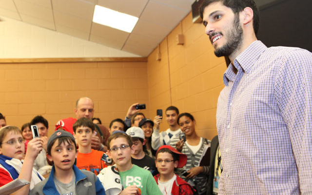 Omri Casspi, the first Israeli in the NBA, greets fans prior to the March 24 game — Jewish Family Night — between the Sacramento Kings and the NJ Nets at the Izod Center in Rutherford. Photo courtesy Melanie Fidler