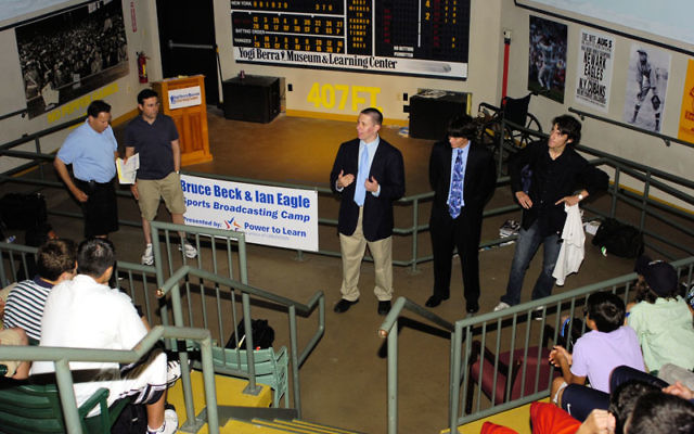 Bruce Beck, far left, and Ian Eagle oversee a session at the Broadcasting Camp. Photo courtesy Bruce Beck & Ian Eagle Sports Broadcasting Camp