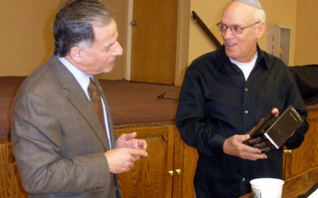 Dr. Stephen Steinlight of the Center for Immigration Studies, left, is presented with a gift after his appearance at Congregation Beth Ohr from men's club president Ed Mendlowitz. Photo by Debra Rubin