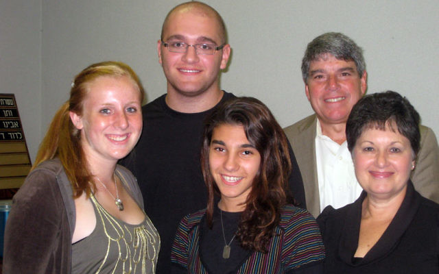 Teens — from left, Danielle Rothenberg, Brian Kleiner, and Aviva Korbman — who received scholarships through the Anne and Herbert Goldstein Fund for Youth Travel to Israel with Gerald and Jo Aimee Ostrov, who established the endowment with t