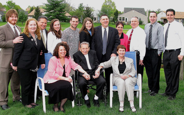 Ascher Goldstein, seated, and his wife, Evelyn, right, seated, with their children, their spouses, and grandchildren, who traveled from throughout the country to see him honored.