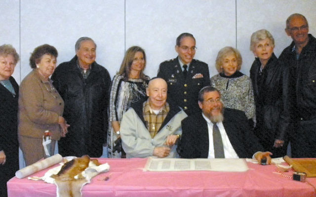 Sofer Zerach Greenfield with Middlesex federation, Monroe community, and military leaders at the Torah for the Troops program at the Jewish Congregation of Concordia. Photo by Debra Rubin