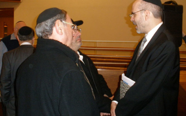 Rabbi Yona Reiss, right, speaks with community members following his Feb. 12 appearance at the Orthodox Forum of Edison/Highland Park. Photo by Debra Rubin