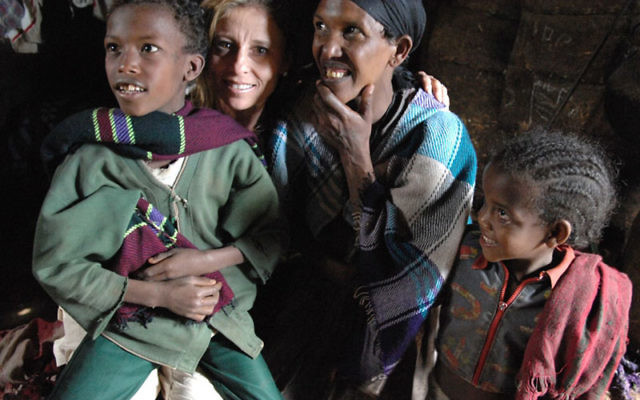 Vanguard honoree Sandy Lenger interacts with children four years ago during a national federations' mission to Ethiopia.