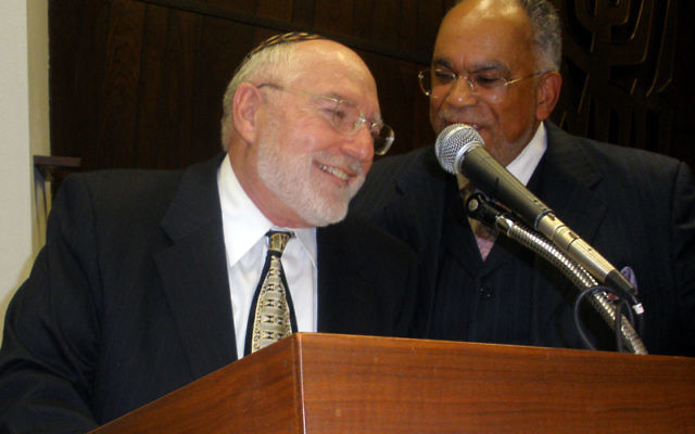 Rabbi Dr. Bernhard Rosenberg of Congregation Beth-El with the Rev. Dr. Ronald Owens of the New Hope Baptist Church and president of the Edison-Metuchen Interfaith Clergy Association, during the Stop the Hate Rally. Photos by Debra Rubin