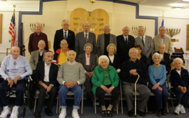 Members of the Jewish Congregation of Concordia who are 90 years old — or older — gather at the Monroe synagogue Oct. 21.