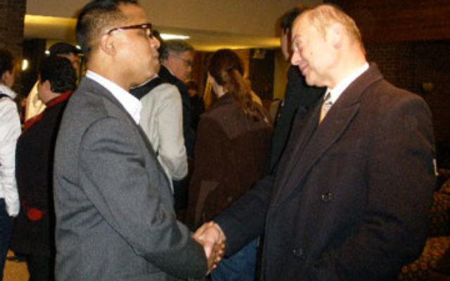 Salah Uddin Shoaib Choudhury, left, is greeted by Rabbi Abraham Mykoff of Congregation Poile Zedek Nov. 1 at Rutgers University.