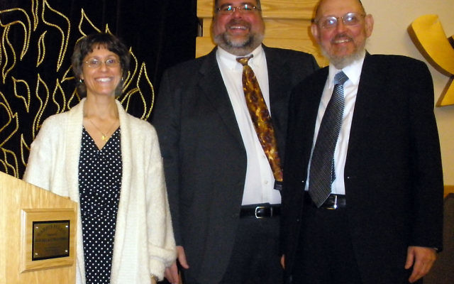 "Mark ""Mutty"" Weiss of Highland Park, center, a child victim of sexual abuse, spoke Jan. 9 at Congregation Ohr Torah in Edison; with him is program chair Deborah Teitz and Rabbi Yosef Blau, a longtime advocate for sexual abuse victims in the Or"