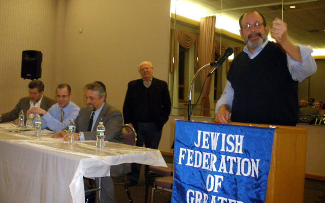 Philip Cantor, chair of the Middlesex JCRC, makes a point during a community meeting to plan pro-Israel activities at Rutgers University. With him are, from left, Martin Raffel of the Jewish Council on Public Affairs; Liran Kapoano, president of the pro-I