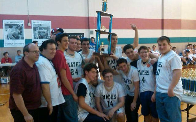 The boys' basketball team from Moshe Aaron Yeshiva High School celebrates last year after winning the Cooper Yeshiva Invitational Tournament in Memphis. MAYHS will close its doors next month after 18 years. Photo courtesy Moshe Aaron Yeshiva High Sc
