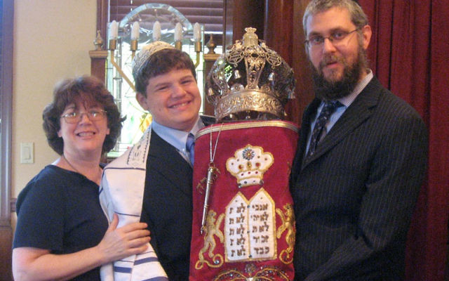 "Jesse Martinez of East Windsor with his mother, Sari Yates, and Rabbi Eliezer Zaklikovsky. Jesse's bar mitzva was ""the best moment"" of his mother's life. Photo courtesy Chabad Jewish Center of Monroe"