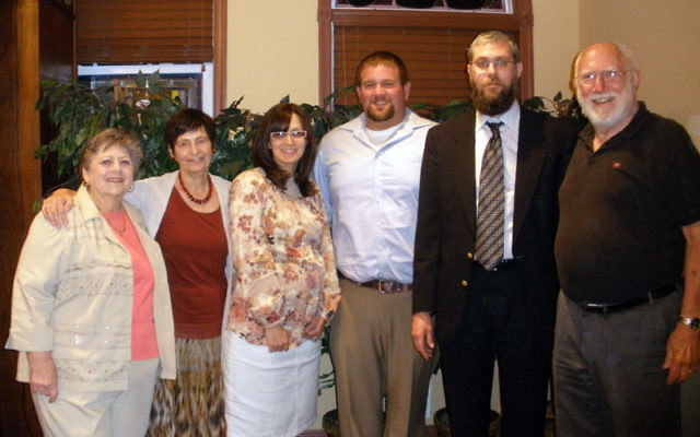 Casey Condra, fourth from left, at the Chabad Jewish Center in Monroe with, from left, Lynn Hertz, Ruth Adler, Chanie Zaklikovsky, Rabbi Eliezer Zaklikovsky, and Larry Hertz. Photo by Debra Rubin