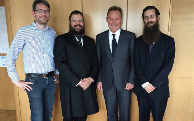 Yehudah Teichtal, second from left, and Thomas Oppermann, third from left, in Berlin on June 28, 2016. (Courtesy of Yehudah Teichtal's office)