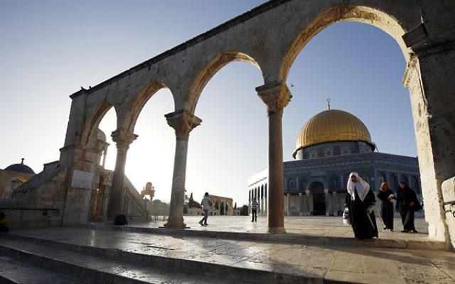 Muslims seen at the Al-Aqsa Mosque, in Jerusalem's Old City, on their way to pray on the second day of the holy Muslim month of Ramadan, June 30, 2014. (Sliman Khader/Flash90)