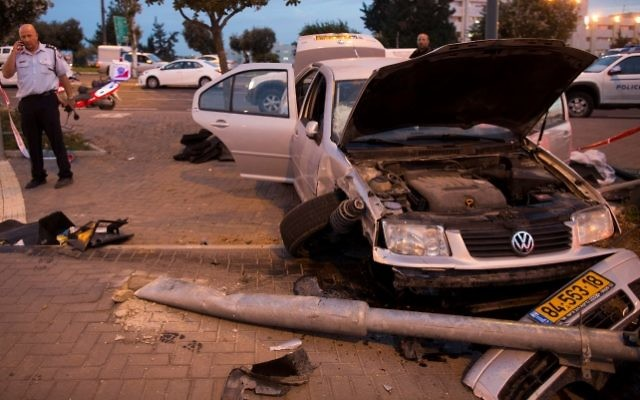 The car that crashed into a Jerusalem train station, killing 3-month-old Chaya Zissel Braun and injuring seven. (Yonatan Sindel/Flash90, via JTA)