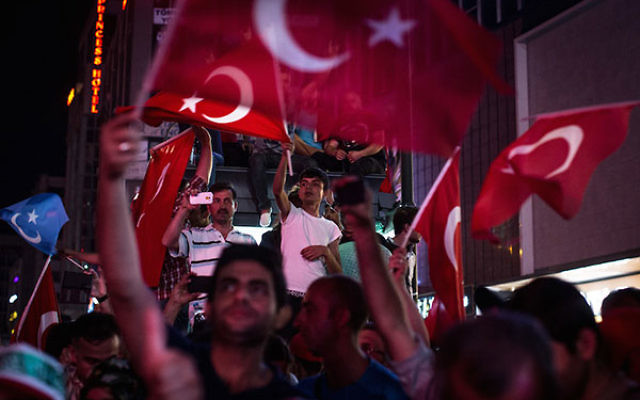 Turks waving their nation's flag at a rally in Ankara's Kizilay Square in reaction to the failed military coup, July 17, 2016. (Chris McGrath/Getty Images)