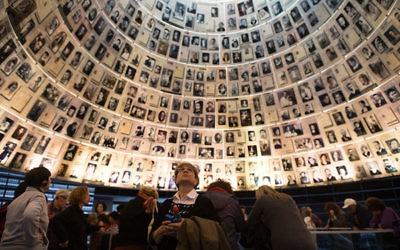 Illustrative photo: Visitors gather in the Hall of Names at Yad Vashem in Jerusalem on Jan. 27, 2014, International Holocaust Remembrance Day. Getty Images