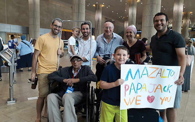 Jack Nasielski of Edison is greeted at Ben-Gurion Airport in Tel Aviv by three generations of his family. (Photo Courtesy Baruch Jacobi)