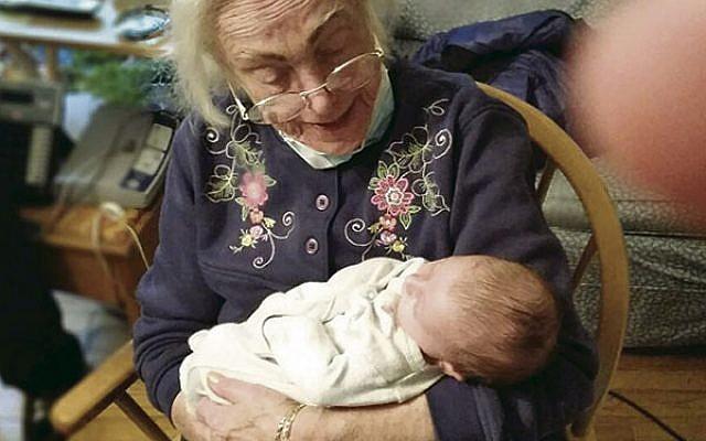 Miriam Miller holds her first great-granddaughter, Alexandra Dava Eisenberg.