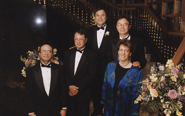 Reunited after years apart: the Kolber siblings, from left, Michael, Harry, George, and Charles, and their American-born half-sister, Regina Kolber.   Photo courtesy the Kolber family