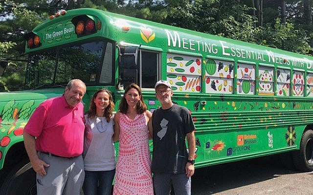 "From left, MEND board chair Jamie Anthony, MEND executive director Robin Peacock, and run organizers Jessica Lituchy and Tim Lyons with ""The Green Bean."" Photo courtesy Jessica Lituchy"