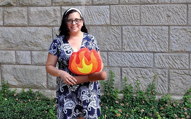 Sharon Diamondstein, new director of congregational learning at the Jewish Center in Princeton, with a Lag b'Omer prop. Photo by Michele Alperin