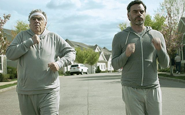 "Father and son — Bob (Elliott Gould) and Nate (Jemaine Clement) — power walk through Cranberry Bog, an ""adult lifestyle community"" in New Jersey."
