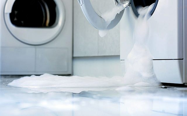 Illustrative image of an overflowing washing machine. Stock Image/The Spruce