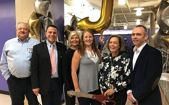 JCC MetroWest leaders, from left, Stuart Raynor, Chris Strom, Sharon Tobey, Krystin Swift, Caren Ford, and Graeme MacLennan at the Sept. 21 ribbon cutting for the upgrade to its fitness center. Photo by Jonathan Stansfield
