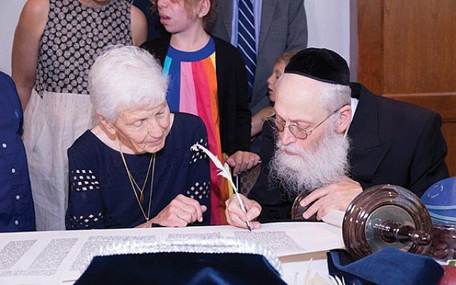 Paula Gottesman with scribe Rabbi Moshe Klein. Photos courtesy Friendship Circle
