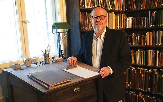 Rabbi Jeffrey Saks in Agnon's library, in Agnon House, surrounded by Agnon's books.